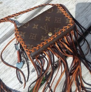 Fringed Louis Vuitton wallet handbag